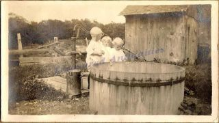 1910s Young Toddler Girls Standing at Hand Water Pump Cistern Tank