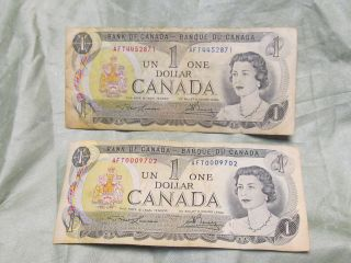 2x 1973 CANADA $1.00 ONE DOLLAR BILLS   LOW SERIAL NUMBER CIRCULATED