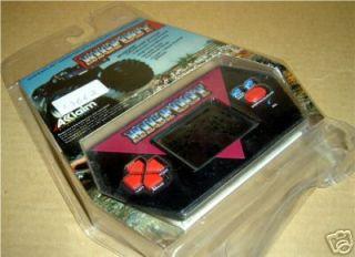 80s ACCLAIM BIG FOOT MONSTER TRUCK HANDHELD LCD GAME MI