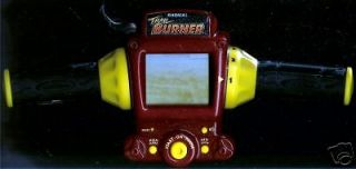 DIRT BIKE RADICA ELECTRONIC HANDHELD MOTORCYCLE VIDEO LCD TOY GAME