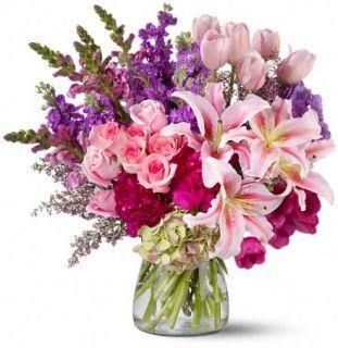 Resplandor Real con una Radiante Combinación de Flores para el Día