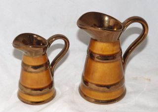 Elijah Cotton Lord Nelson Pottery Set of Two Graduated Copper Lustre