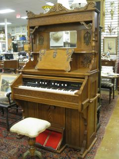 Click the pictures to see our video of this antique pump organ