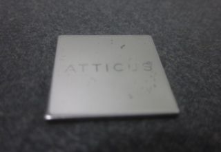 you are bidding on a new atticus black silver toned marble cutting
