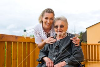 Young nurse and female senior in a wheel chair Royalty Free Stock