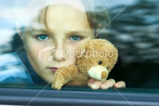 stock photo 10713328 sad girl in car