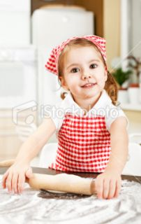 stock photo 15125960 cute little girl with rolling pin
