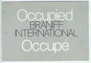braniff international seat occupied sign occupe