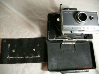 Vintage Polaroid Automatic 100 Land Camera with manual, case and