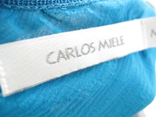 you are bidding on a carlos miele blue sleeveless top shirt in a size