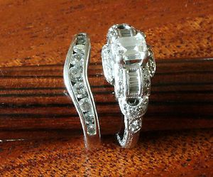 Platinum engagement ring with VS1 G emerald cut center diamond