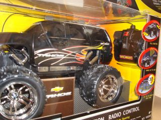 CAR REMOTE CONTROL CHEVY TAHOE BATTERY OPERATED FWD RVS R L NEW IN BOX