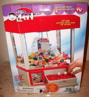 NEW IN BOX THE CLAW TOY CANDY GRABBER CRANE ARCADE MACHINE GAME