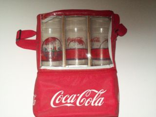 coca cola cooler with glasses