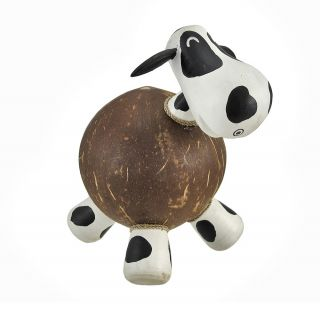 this cute coin bank is made from a recycled coconut shell and painted