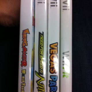 Lot of 4 Nintendo Wii games Wii Fit Vegas Party Nitro Fishing Master