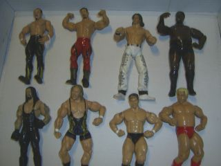 Lot of 8 Wrestling WWE WWF Action Figures