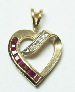this solid 14k yellow gold heart shaped pendant features eight
