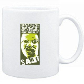 Mug White  Crazy people do crazy things, but West