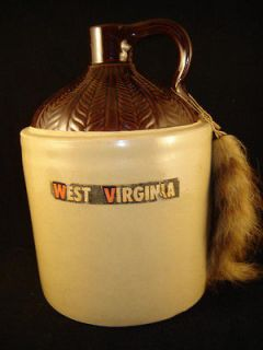 West Virginia Mountain Moonshine pottery jug Raccoon tail whiskey