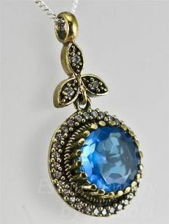 Deco Rose Gold/Sterling Silver 5.10ctw Blue & White Topaz Pendant 4.2g