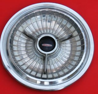1963 Olds deluxe w/spinner hub cap with white ring