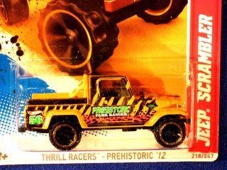 Hot Wheels 2012 Jeep Scrambler Yellow 56 Prehistoric Park Ranger Logo